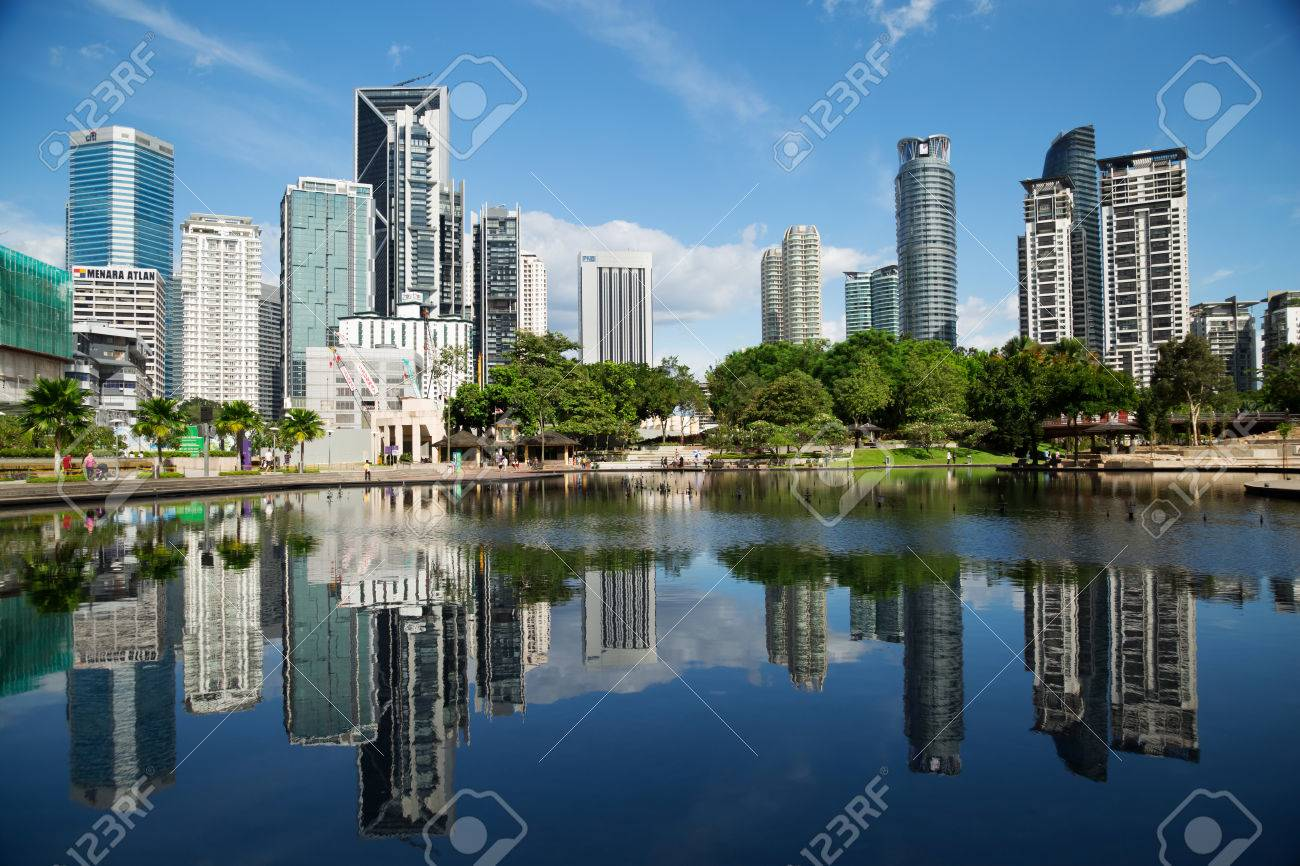 Kuala Lumpur, Malaysia - January 30, 2016: The KL City Centre Park in Kuala Lumpur, Malaysia. View on modern skyscrappers. - 54761686