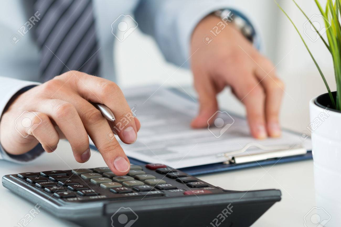 Close up of male accountant or banker calculating or checking balance. Bookkeeper or financial inspector making financial report. Home finances, investment, economy, saving money or insurance concept - 60086908
