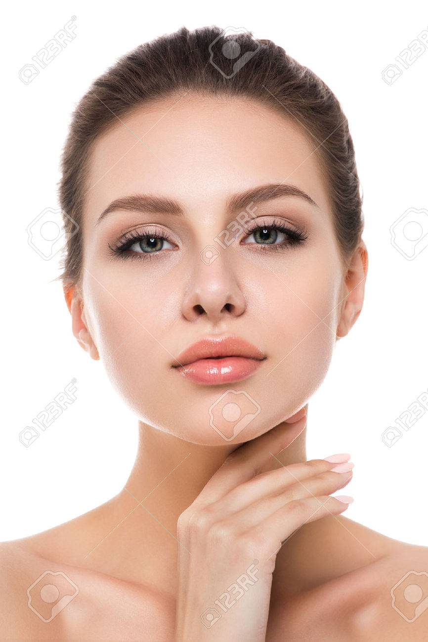 Portrait of young beautiful caucasian woman touching her face isolated over white background. Cleaning face, perfect skin. SPA therapy, skincare, cosmetology and plastic surgery concept - 60087367