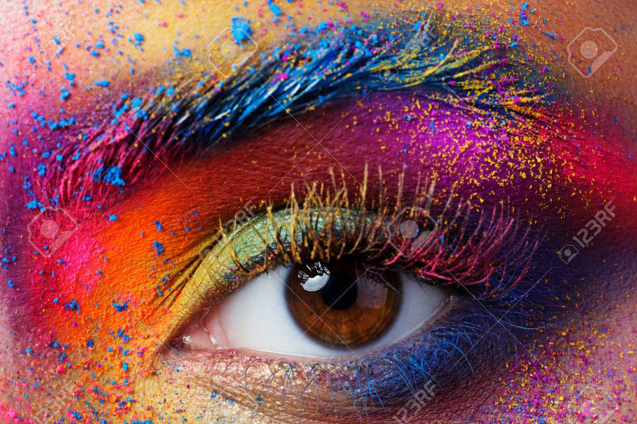 Close up view of female eye with bright multicolored fashion makeup. Holi indian color festival inspired. Studio macro shot - 68488186