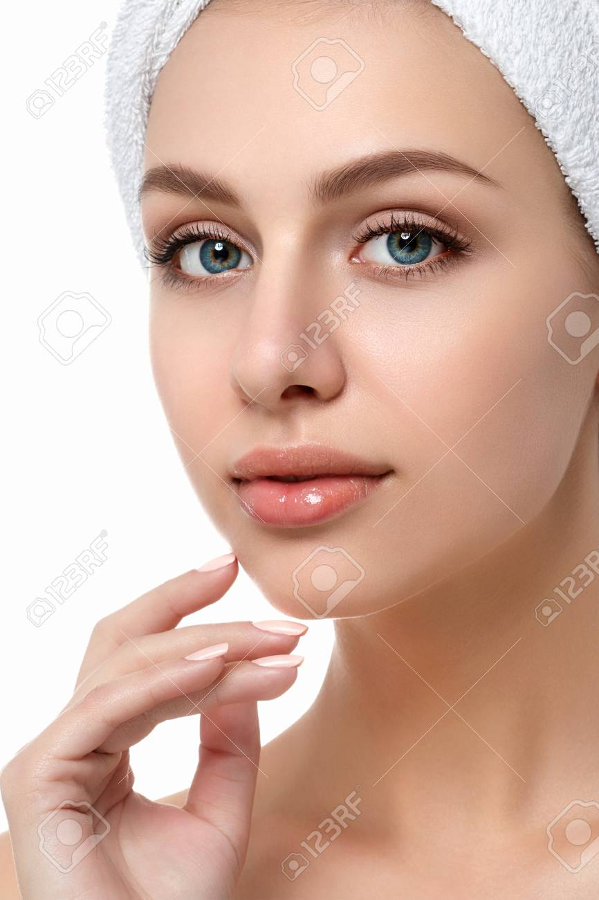 Portrait of young beautiful caucasian woman touching her face isolated over white background. Cleaning face, perfect skin. SPA therapy, skincare, cosmetology, hair removal or plastic surgery concept - 93529279
