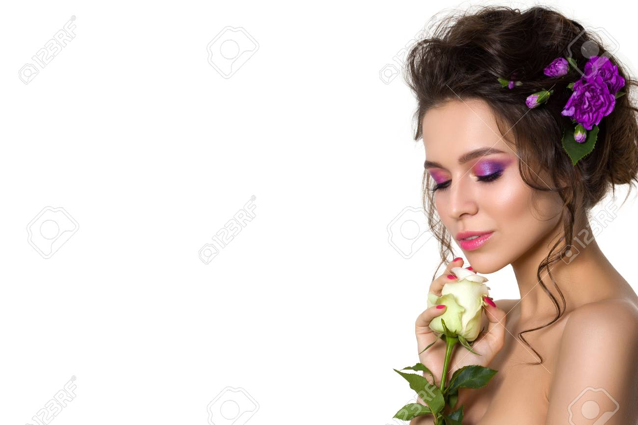 Portrait Of Young Beautiful Woman With Violet Flowers In Her