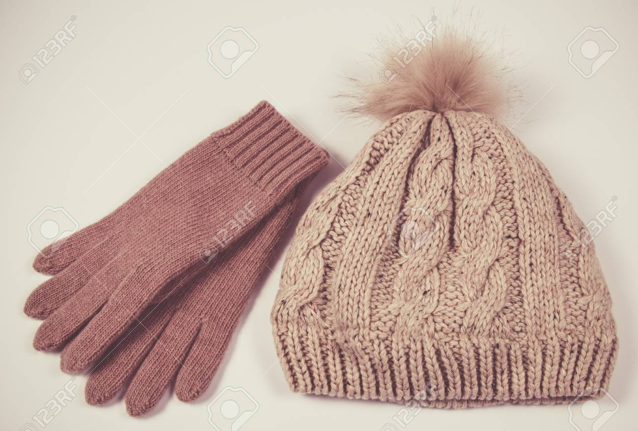 Stock Photo - Women s woolen hat and gloves for winter weather on a white  background. Close Up. 5d518eb0960