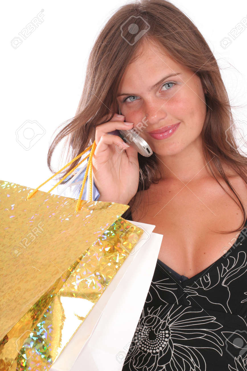 a smiling woman with a shopping bags and a mobile Stock Photo - 2019778