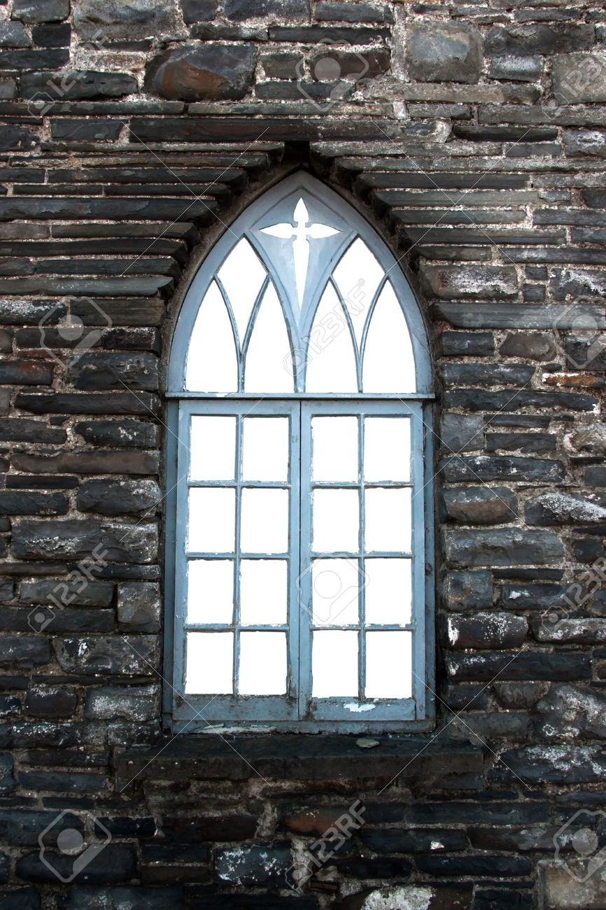 An Old Castle Arch Shaped Window Against A Stone Wall Stock Photo ...