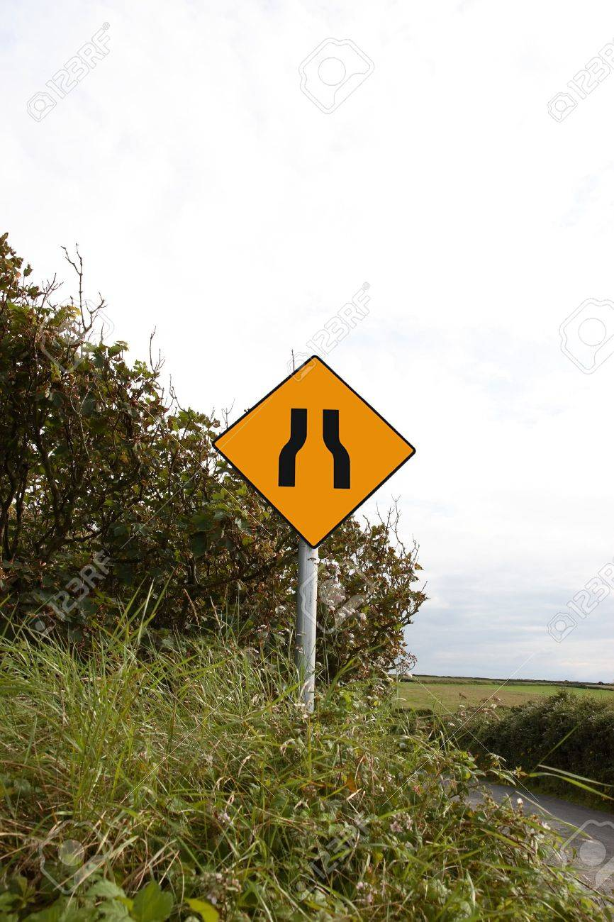 a sign warning of the road narrowing ahead in ireland Stock Photo - 3618561