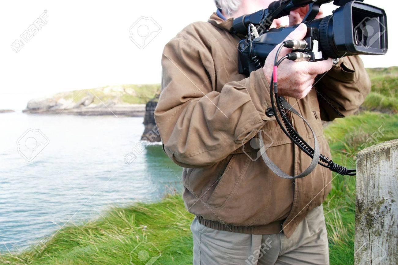 a cameraman filming on the cliff edge in ballybunion ireland - 3729678
