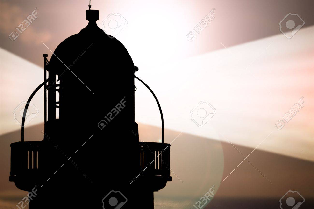 lighthouse captured with the sun behind it and beams on Stock Photo - 4587916