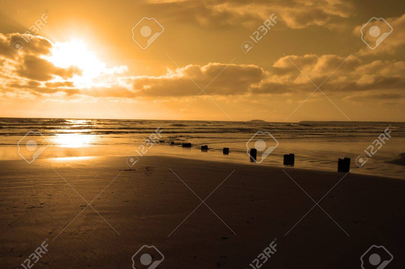 wave breakers at sunset on a golden beach in youghal county cork ireland Stock Photo - 4813041