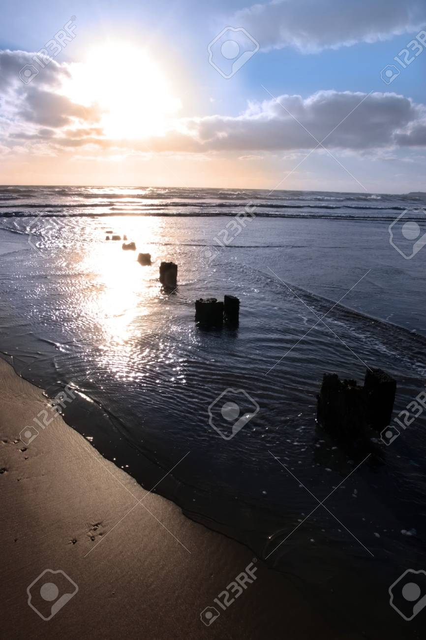 wave breakers at sunset on a beach in youghal county cork ireland Stock Photo - 4813045