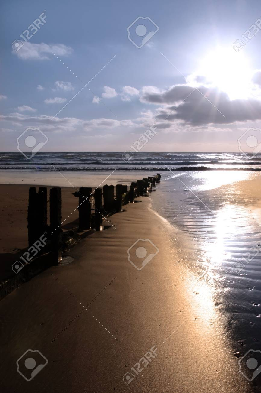 wave breakers at sunset on a beach in youghal county cork ireland Stock Photo - 4813047