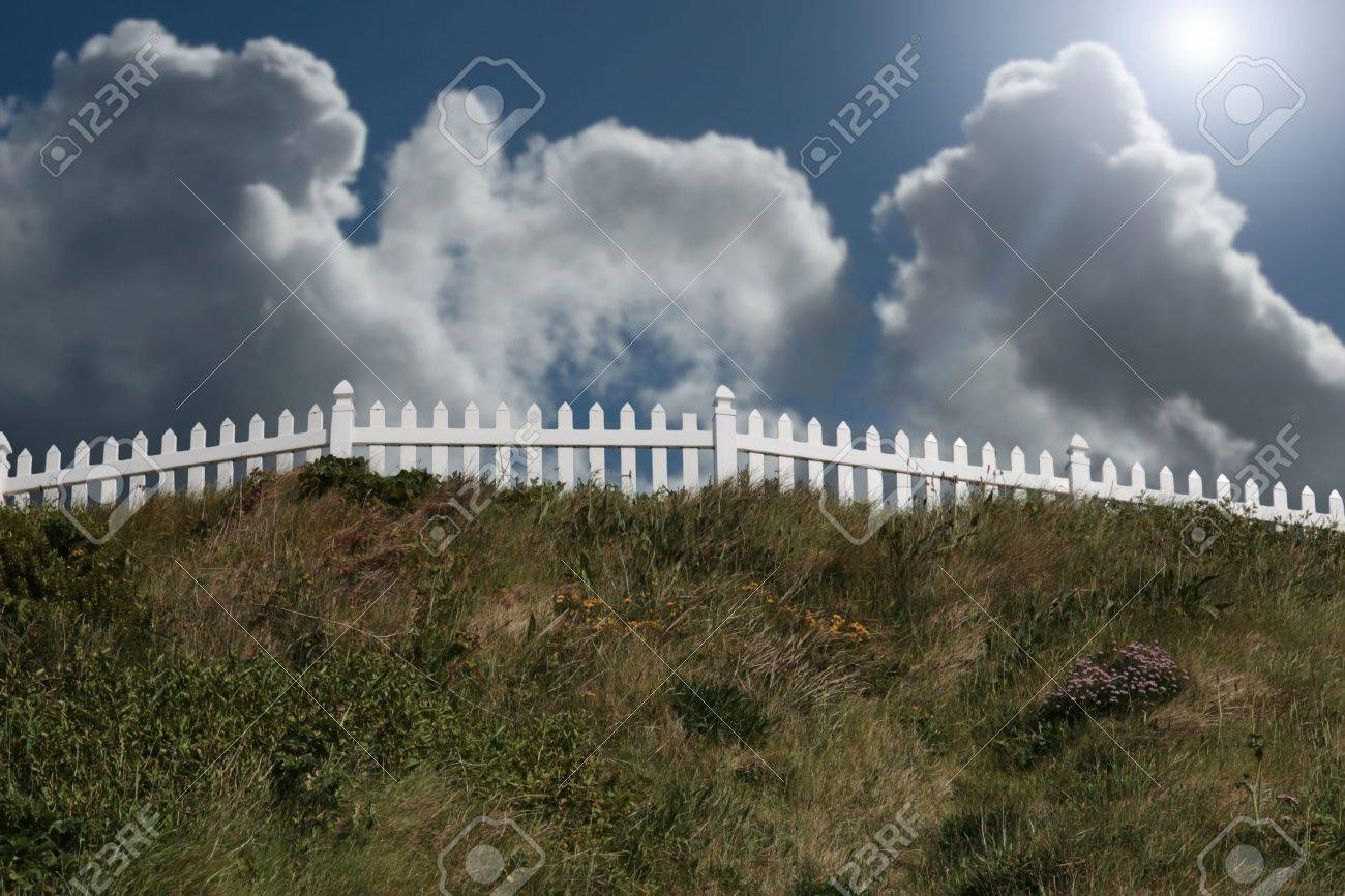 a white picket fence on top of a hill Stock Photo - 5184303