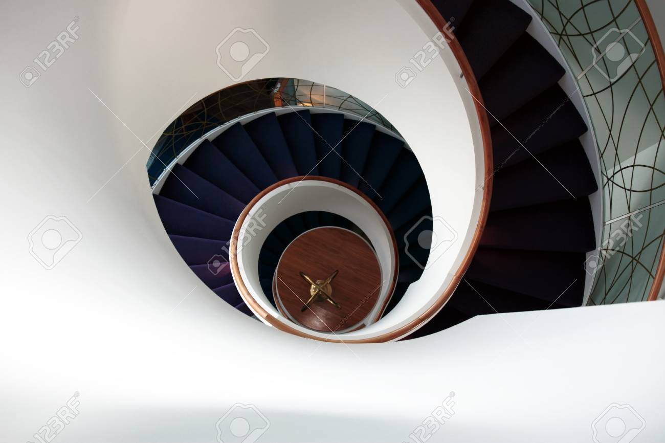a view down a spiral staircase with room for copyspace Stock Photo - 7607949