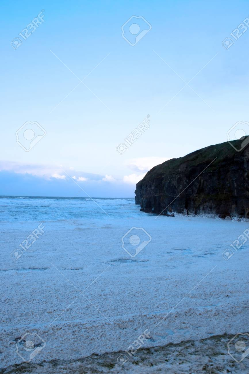 sweeping waves of foam on a dark evening during a storm of the west coast of ireland Stock Photo - 13450344