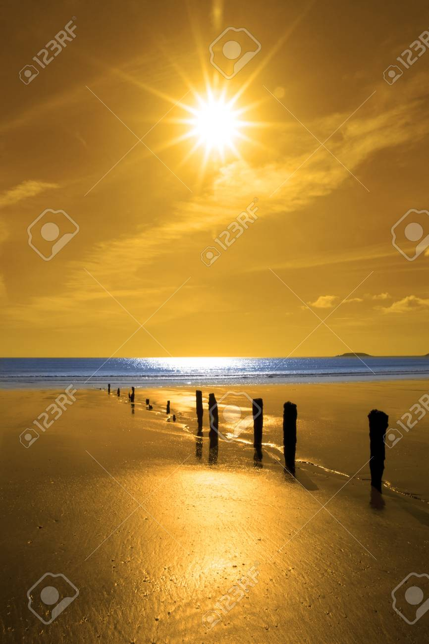 golden sunshine over the beach breakers and blue Atlantic sea in Youghal county Cork Ireland on a summers day Stock Photo - 17297529
