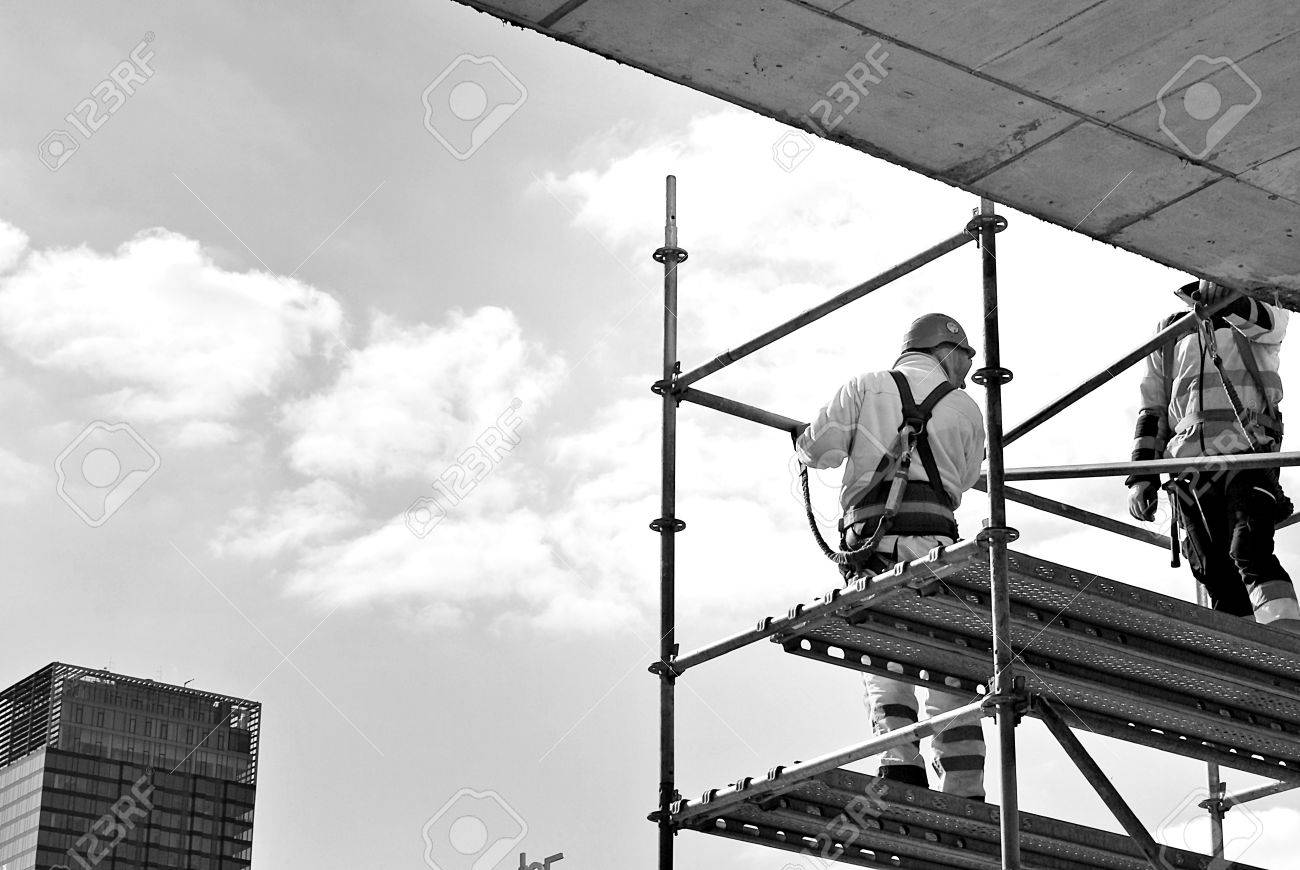 Construction Workers On A Scaffold Black And White Stock Photo