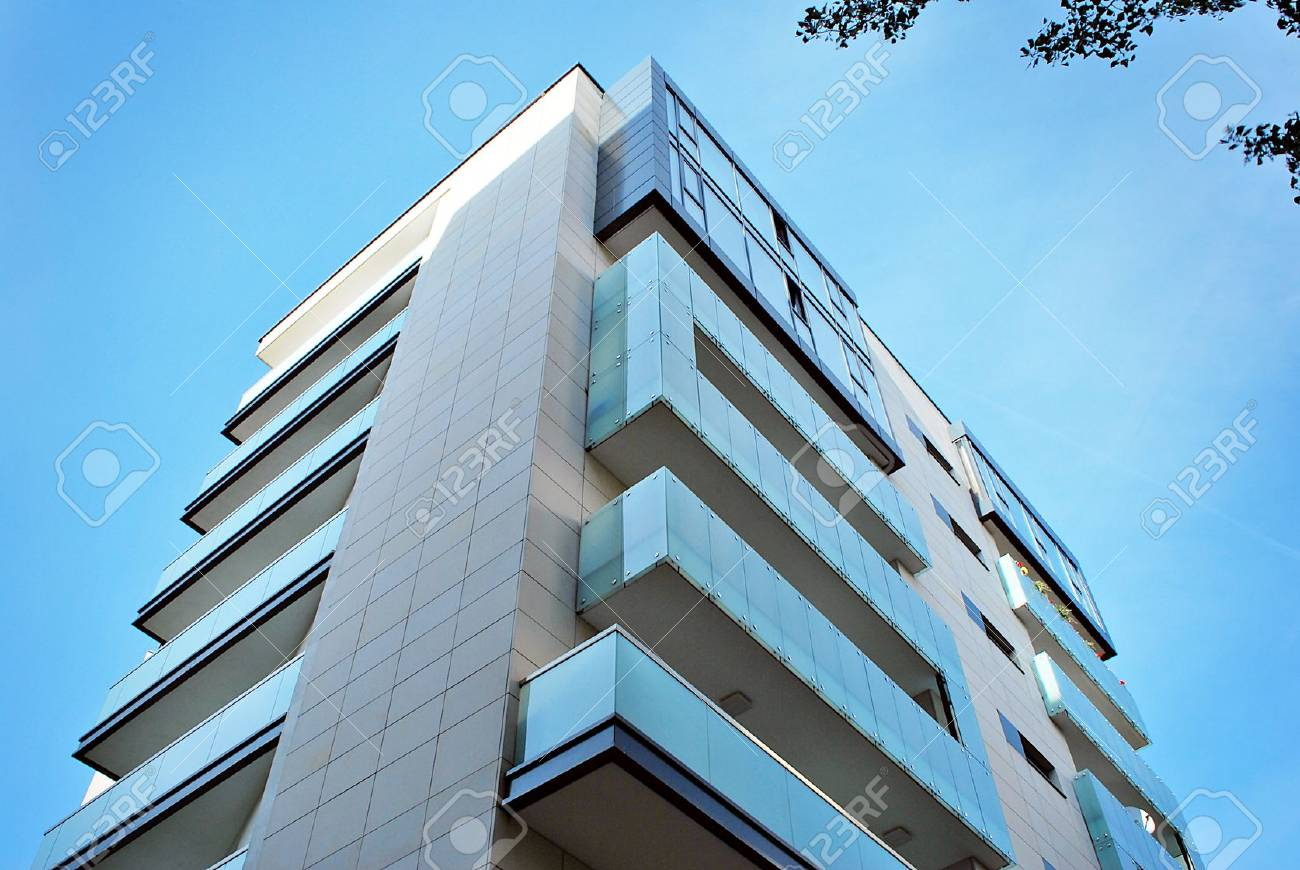 Modern, Luxury Apartment Building against blue sky - 87477242