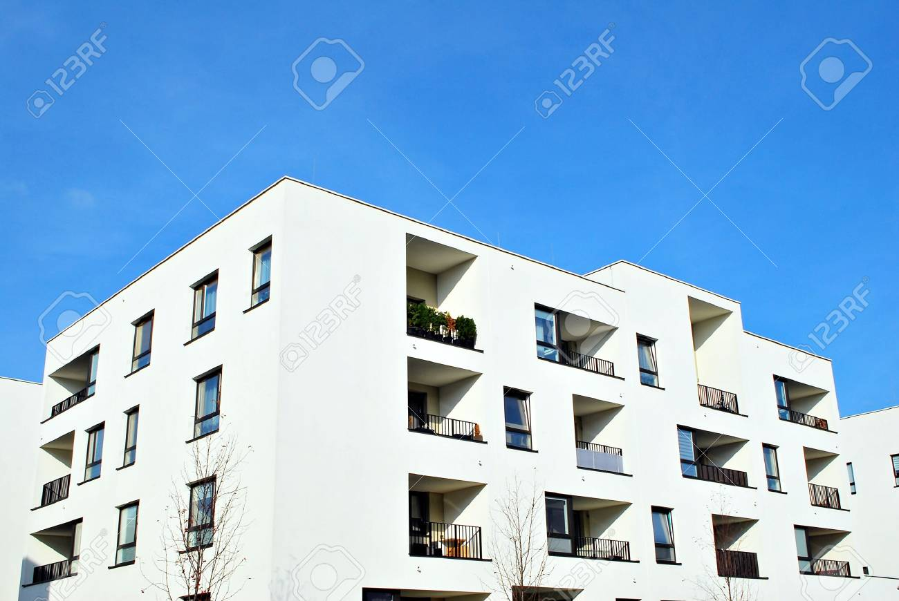 Modern Apartment Buildings On A Sunny Day With A Blue Sky ...
