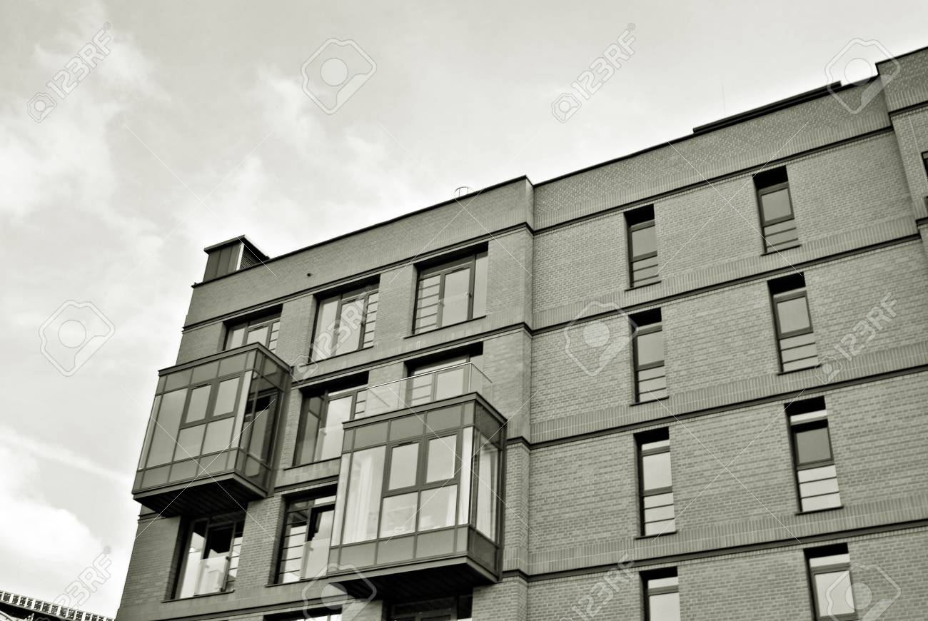 Modern Apartment Building. Facade Of A Modern Apartment Building. Black And  White. Stock