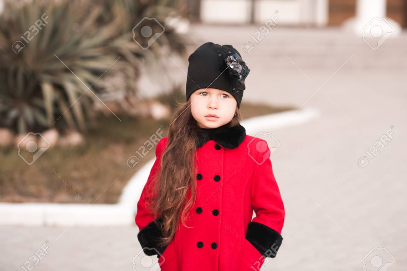 Closeup Portrait Of Cute Baby Girl Posing In Winter Clothes Outdoors