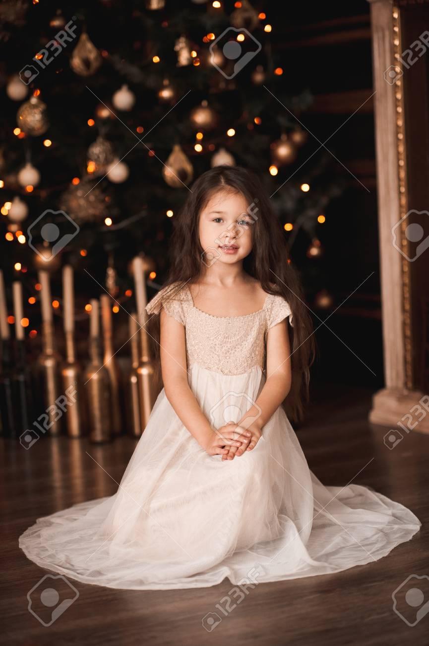 8bbf3bb34 Cute Baby Girl 4-5 Year Old Wearing Stylish Dress Sitting Under ...
