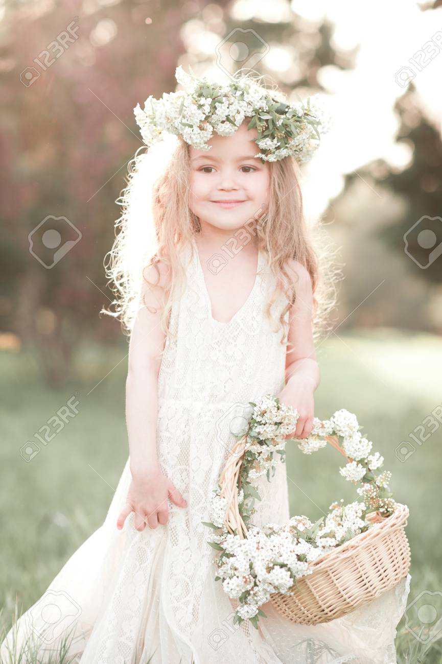 Cute Kid Girl 4-5 Year Old With Basket Of Flowers Wearing Floral ...