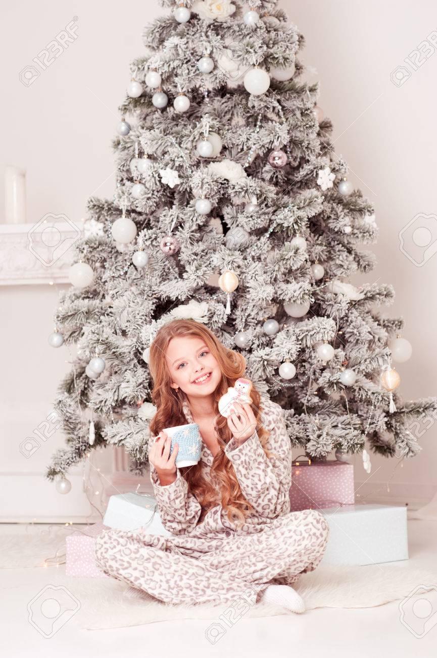 Smiling Teenage Girl 12-15 Year Old Sitting Under Christmas Tree ...