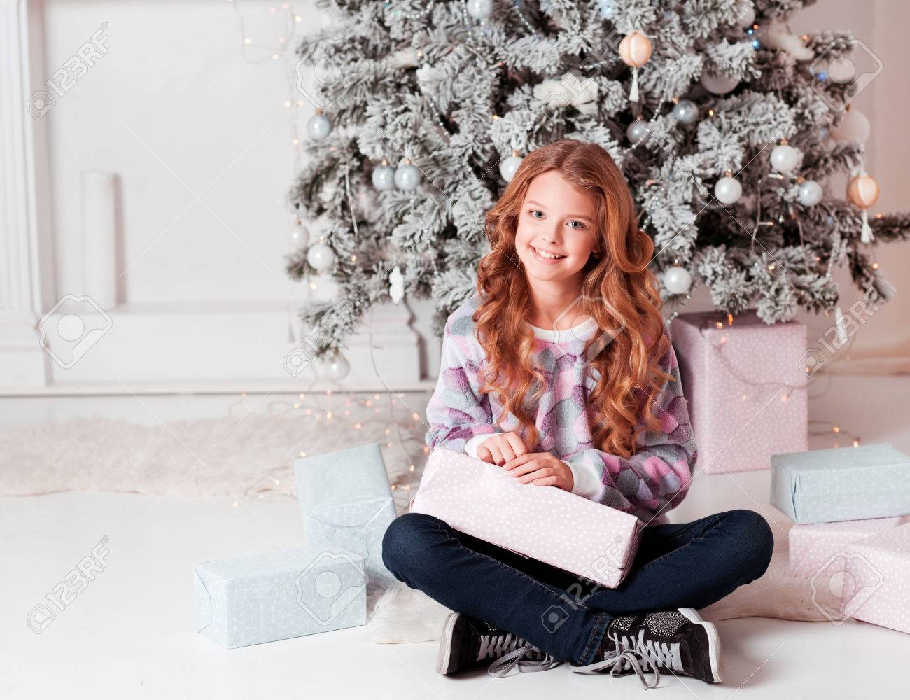 Beautiful Blonde Girl 12-15 Year Old Sitting With Christmas Presents ...