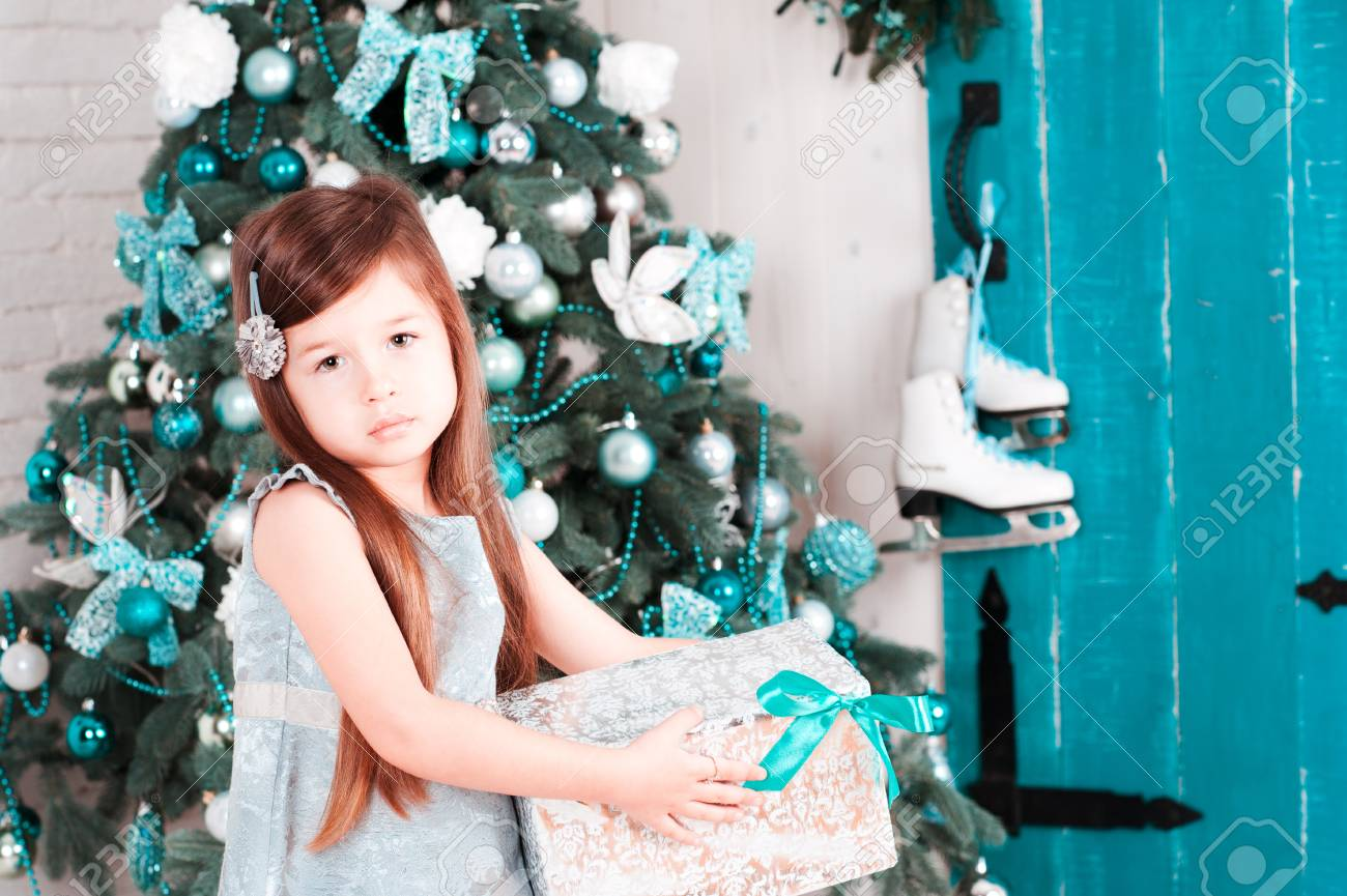 Child Girl 3-4 Year Old Holding Christmas Gift Over Christmas ...