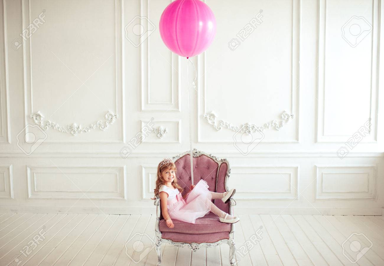 Kid Girl 4 5 Year Old Sitting In Armchair Holding Pink Balloon In Room Over