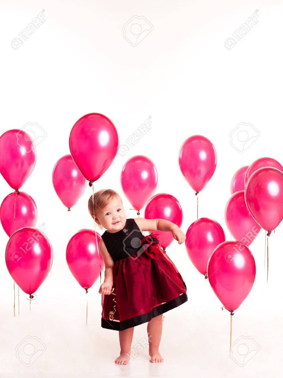 Smiling Baby Girl 1 2 Year Old Playing With Pink Balloons In Room Over White