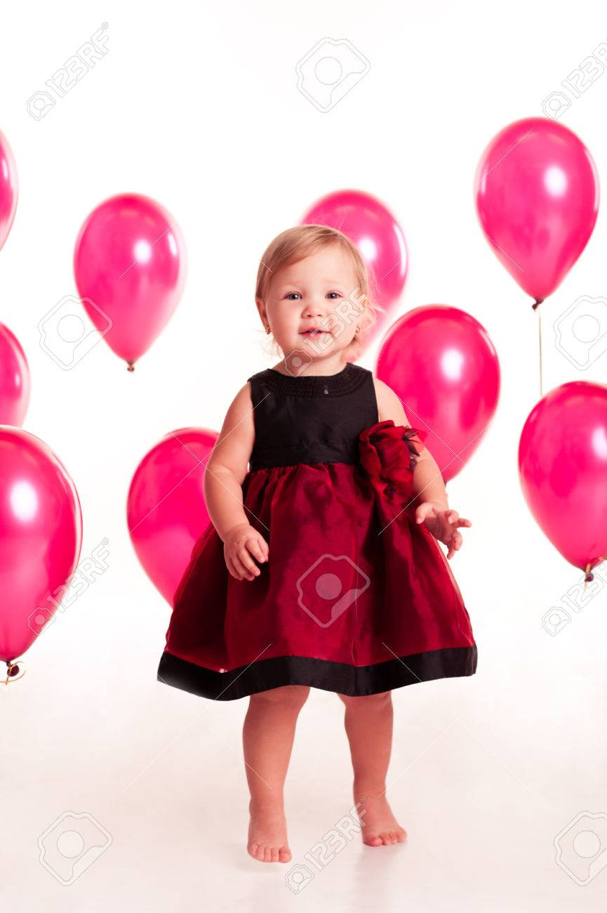 Laughing Baby Girl 2 3 Year Old Having Fun With Pink Balloons In Room Over