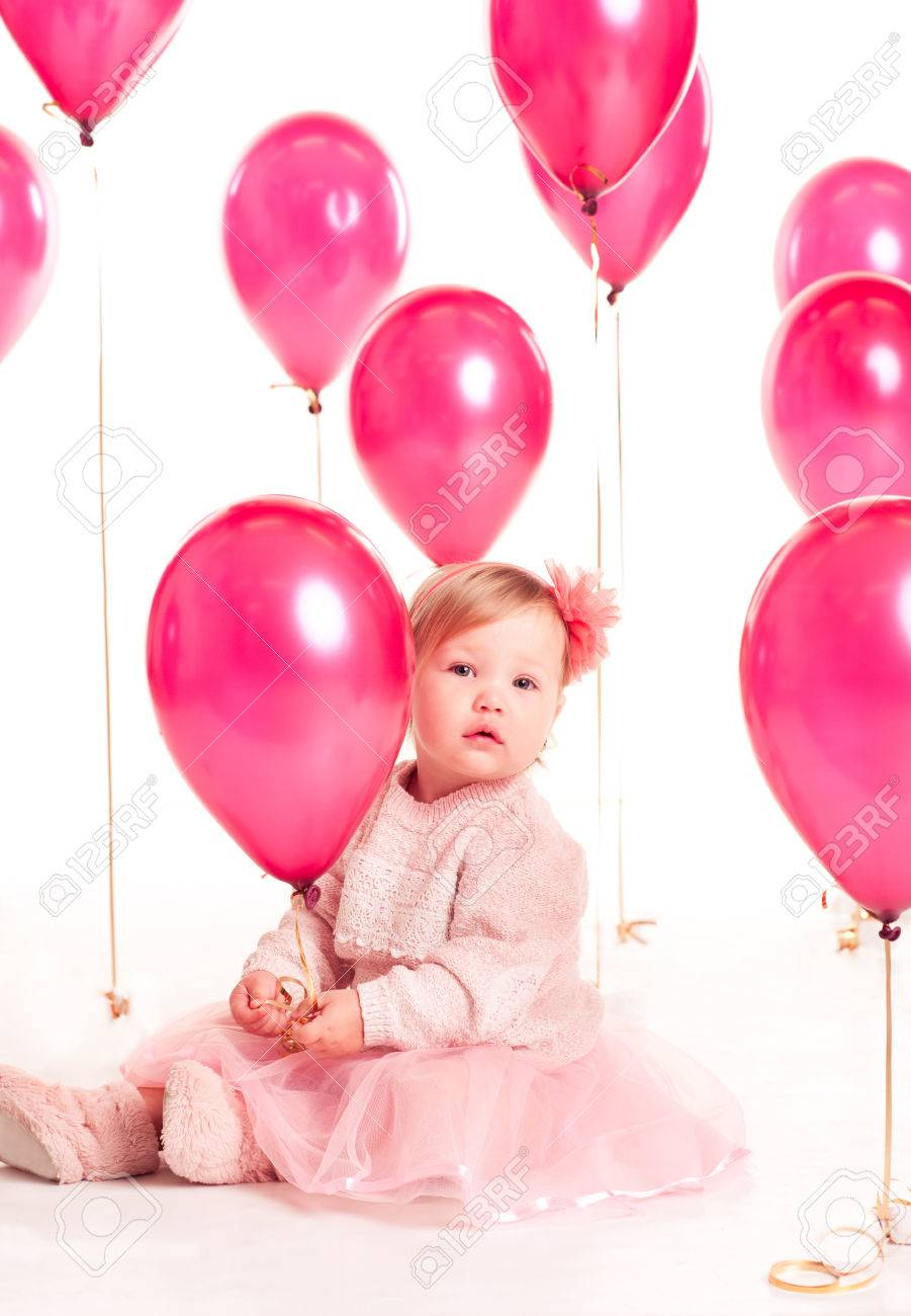 Cute Baby Girl 1 2 Year Old Sitting On Floor With Pink Balloons