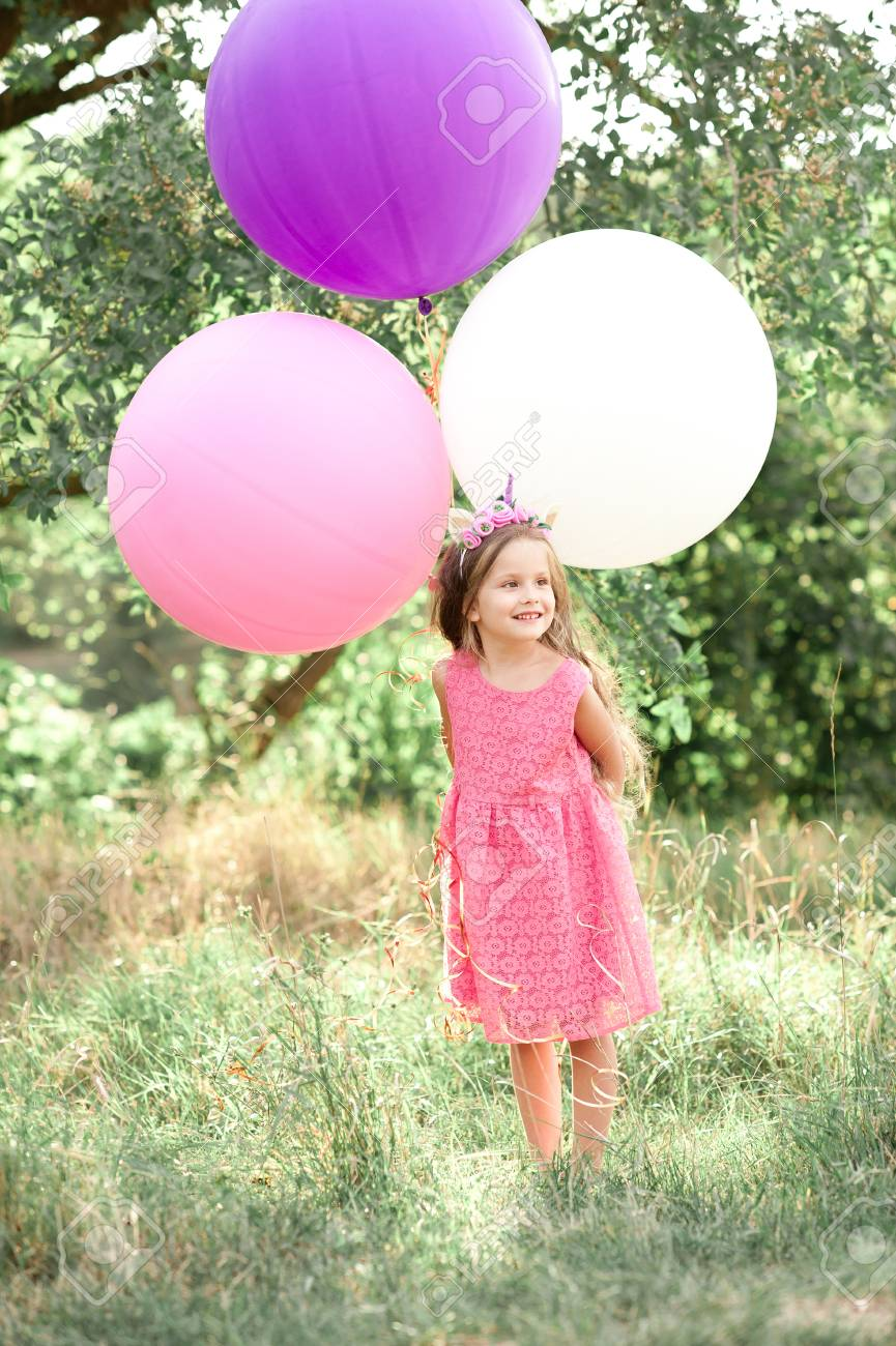 Stylish Kid Girl 4 5 Year Old Holding Balloons Wearing Pink Dress