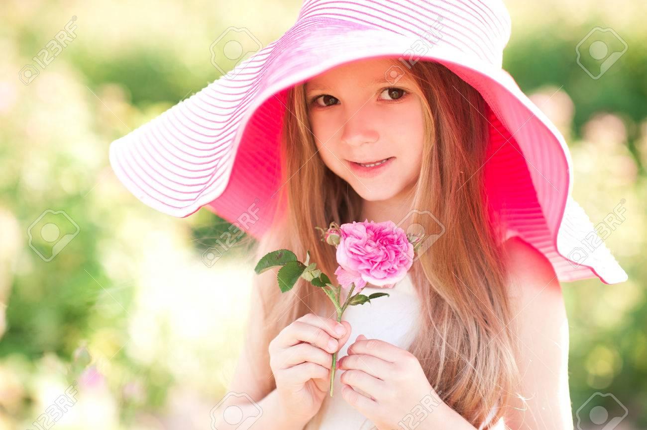 cddd1882238b Smiling Cute Baby Girl 4-5 Year Old Holding Flower Wearing Big ...