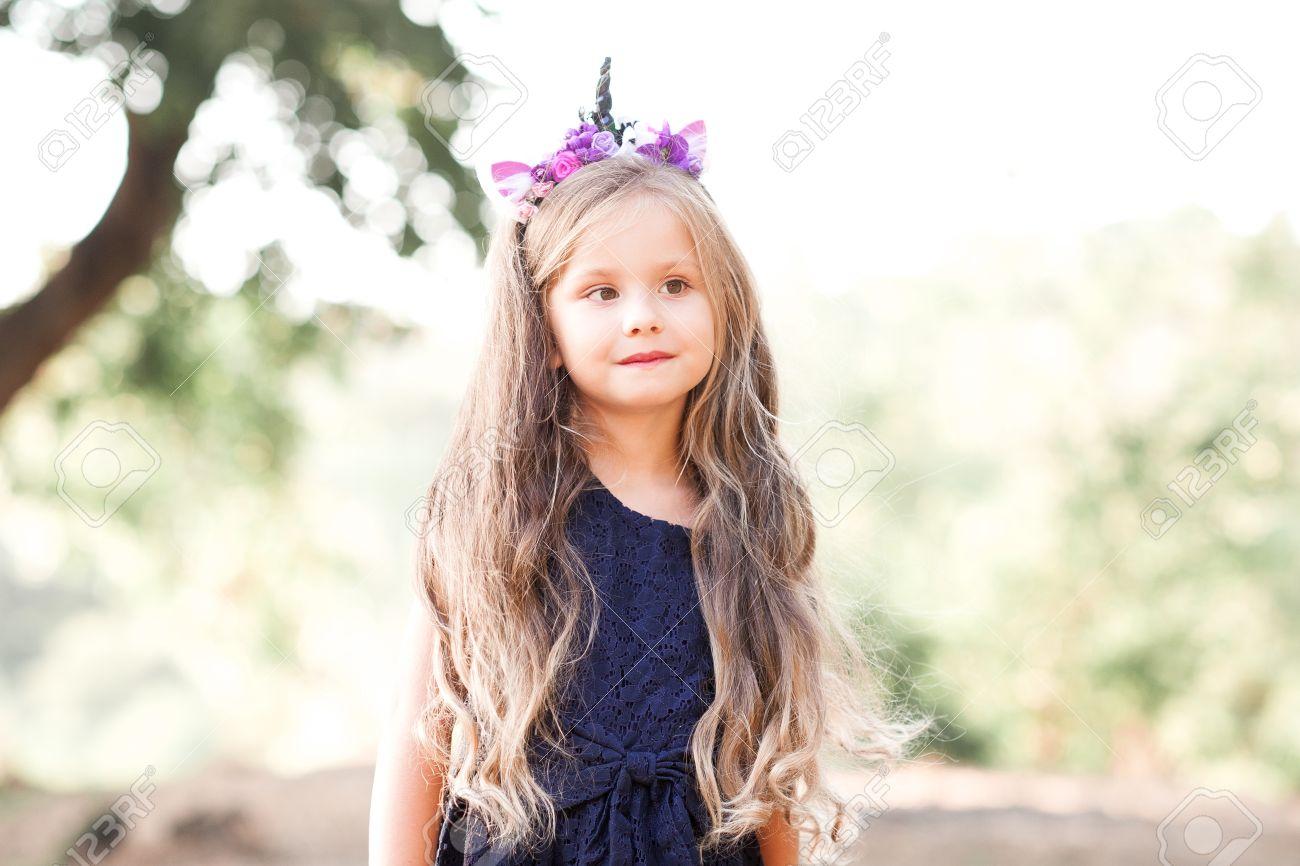 e1a8ea424e84 Cute Baby Girl 4-5 Year Old Wearing Dress And Handmade Headband ...