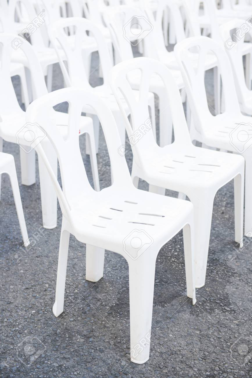 Row of white plastic chairs in outdoor event seat stock photo 54875883