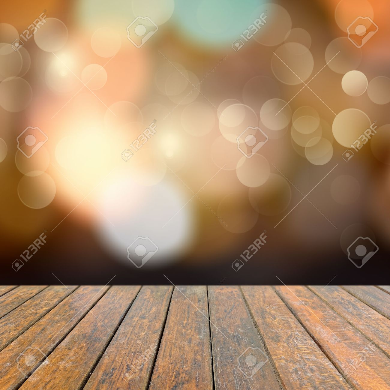 Plain wood table with hipster brick wall background stock photo - Background Brown Old Wooden Deck Table With A Sparkling Bokeh Of Party Lights In The