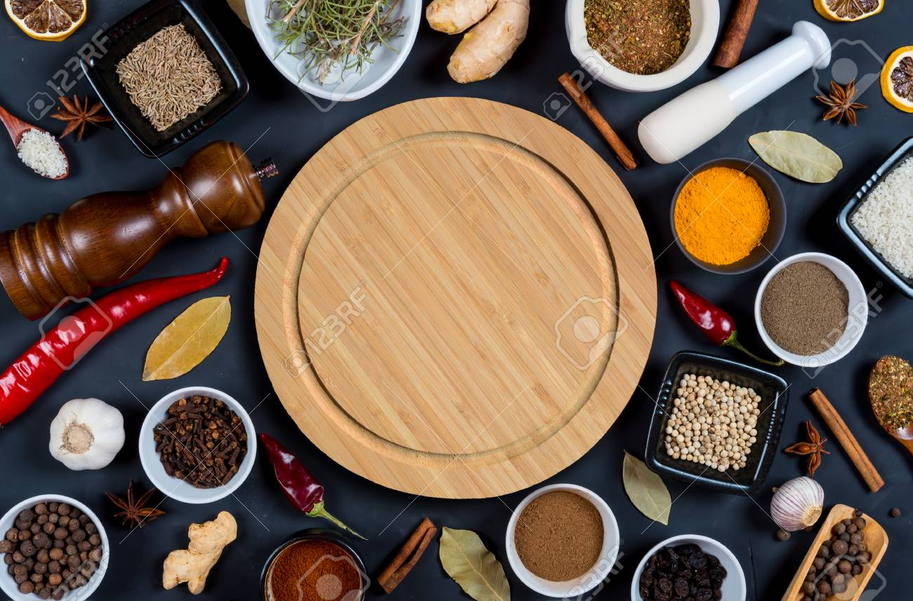Indian Spices Herbs And Empty Round Cutting Board On Black Background Stock Photo Picture And Royalty Free Image Image 74048732