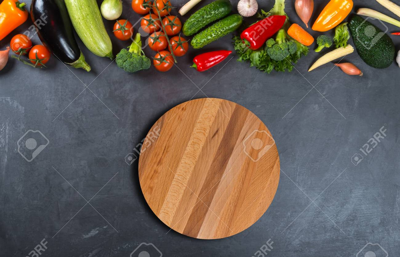 Different Vegetables And Empty Wooden Round Cutting Board On Stock Photo Picture And Royalty Free Image Image 82407049