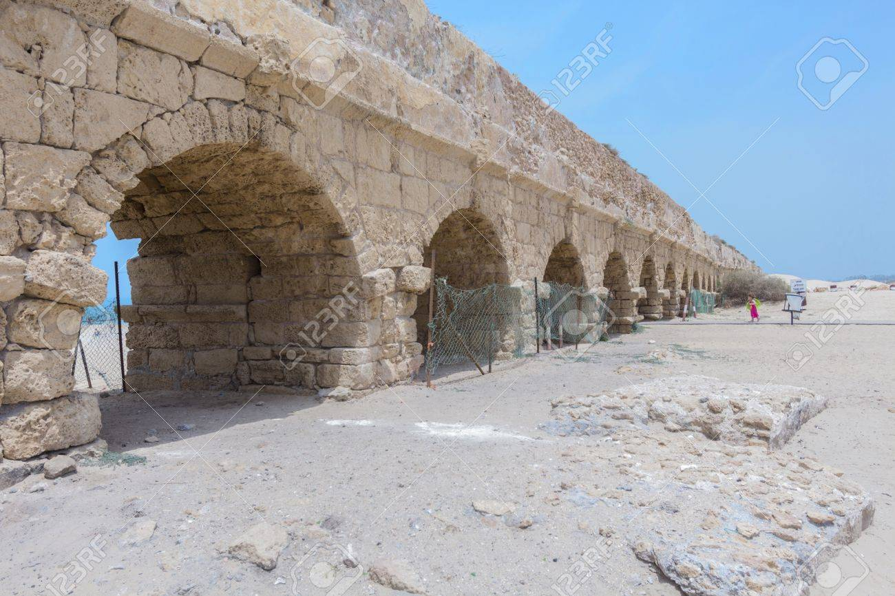 The ancient viaduct on the Mediterranean Sea. Israel. Stock Photo - 20044574