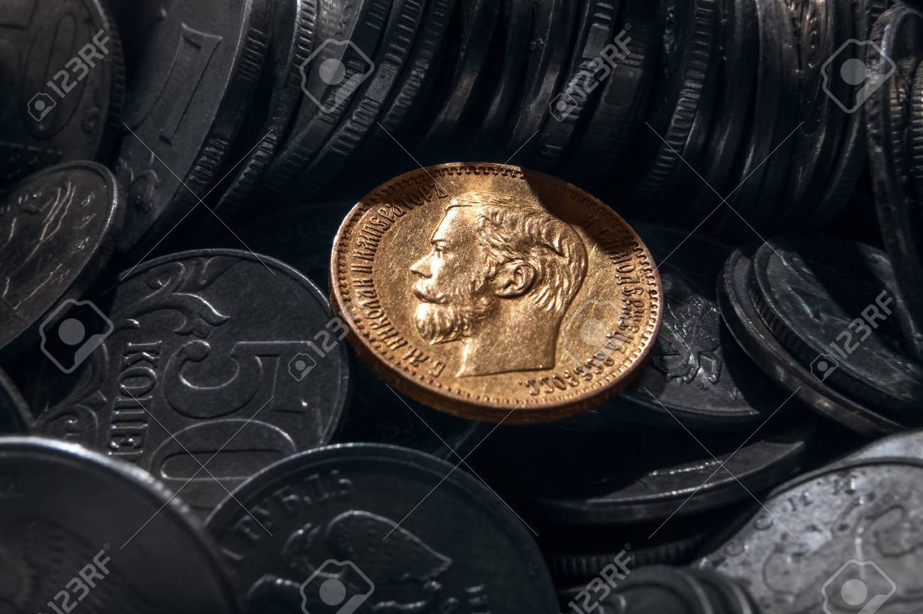 coin from precious metal of gold against the background of coins