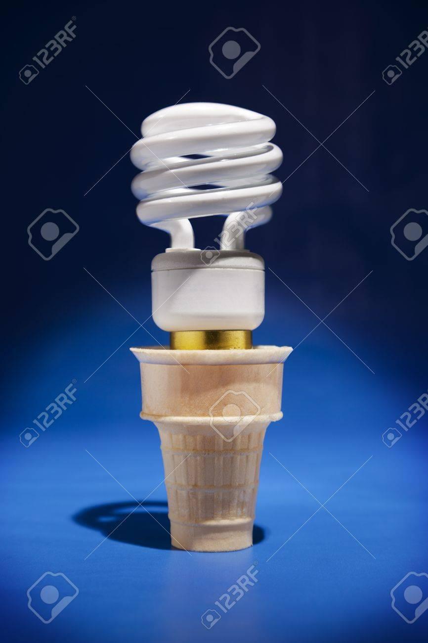 a compact flourescent light bulb sticks out of an ice cream cone
