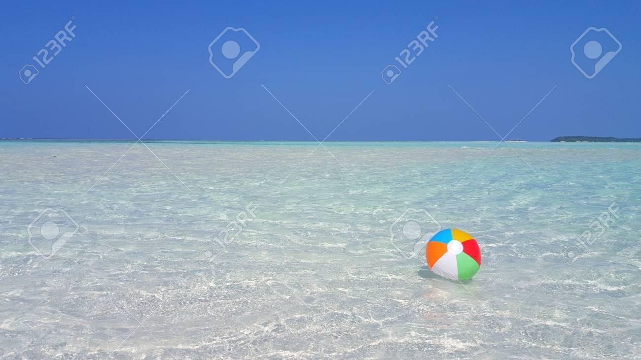 Beach ball in ocean Summer P00219 Maldives White Sandy Beach Ball On Sunny Tropical Paradise Island With Aqua Blue Sky Sea Depositphotos P00219 Maldives White Sandy Beach Ball On Sunny Tropical Paradise