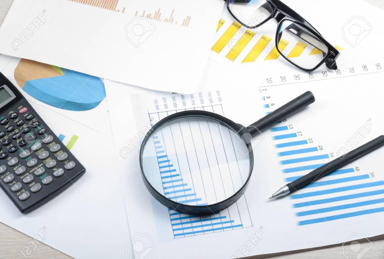 home savings budget concept chart glasses pen calculator
