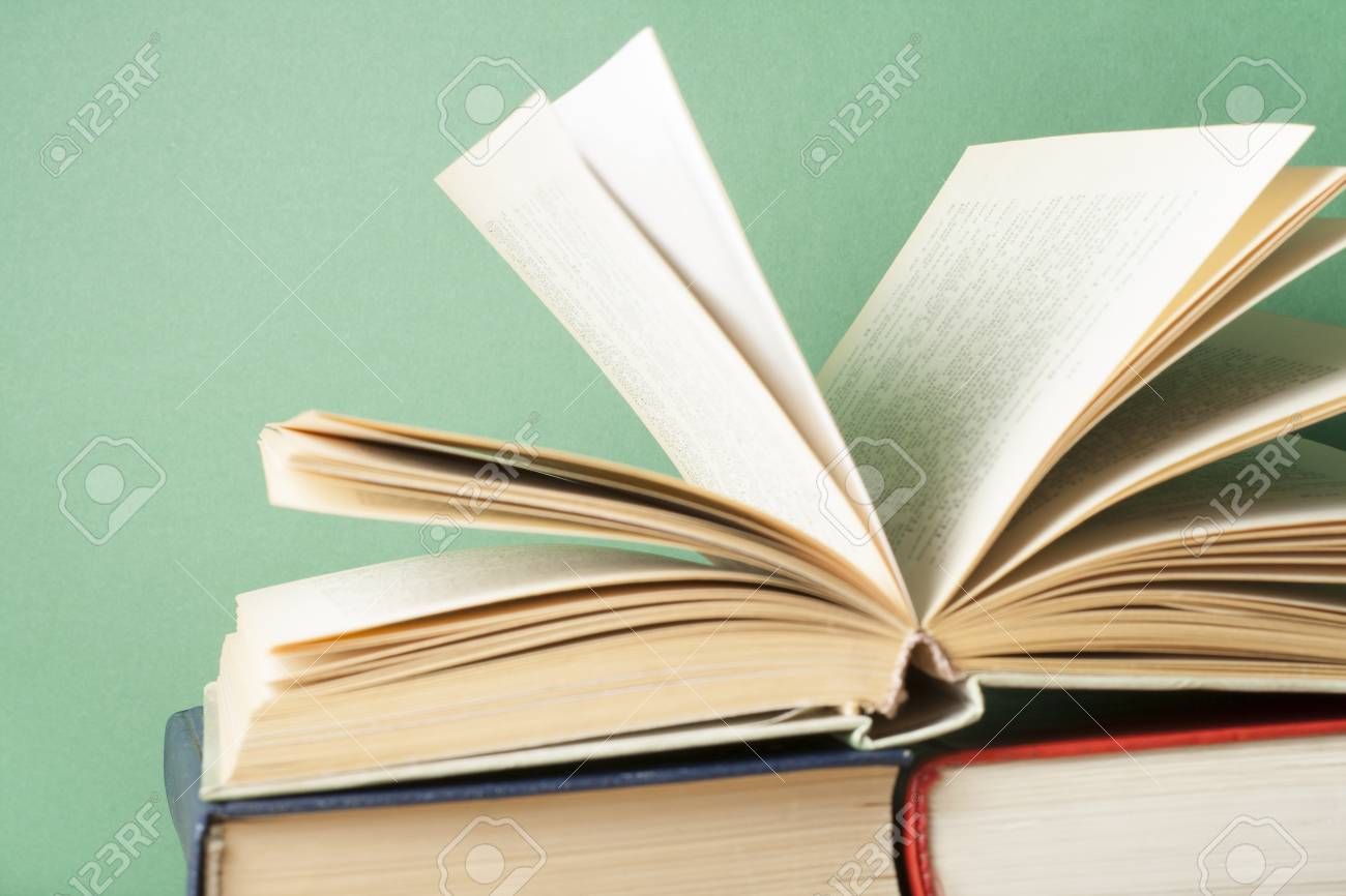 open book hardback books on wooden table education background