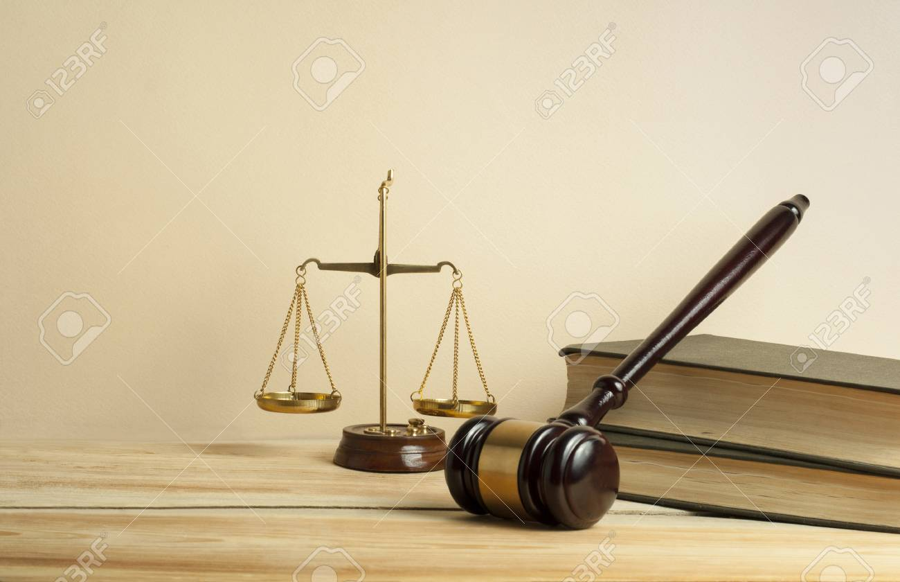 Law concept. Wooden judge gavel,scales of justice and books on table in a courtroom or enforcement office. - 115991036