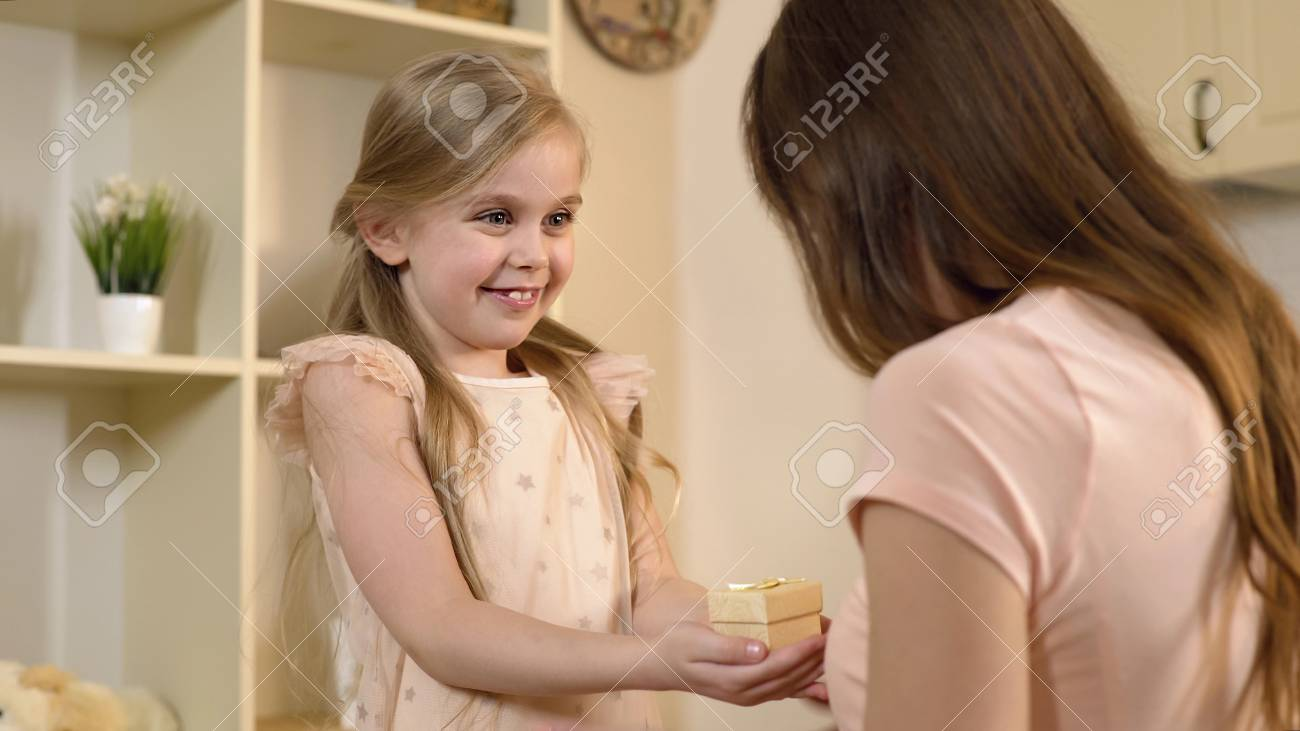 Loving Daughter Presenting Birthday Gift To Mother Tender Surprise From Child Stock Footage