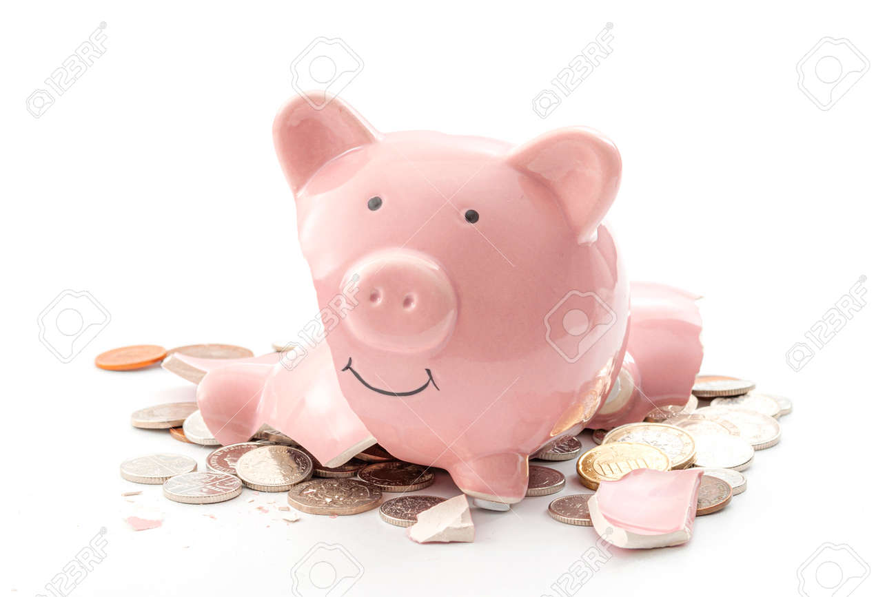 Break the bank, economic downturn and bankruptcy concept theme with a broken piggy bank and scattered coins isolated on white background - 158653117