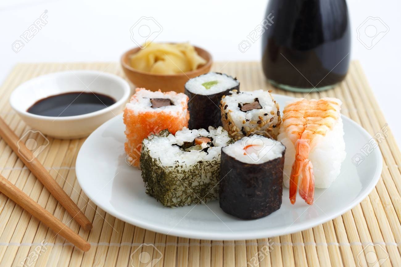 Selection Of Sushi On Bamboo Mat With Chopsticks Soya Sauce